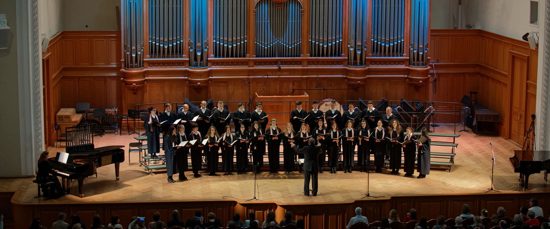 Professor Krotev and the AUBG Choir on the stage of Grand Hall of Moscow Conservatory of Music, Russia  <br />